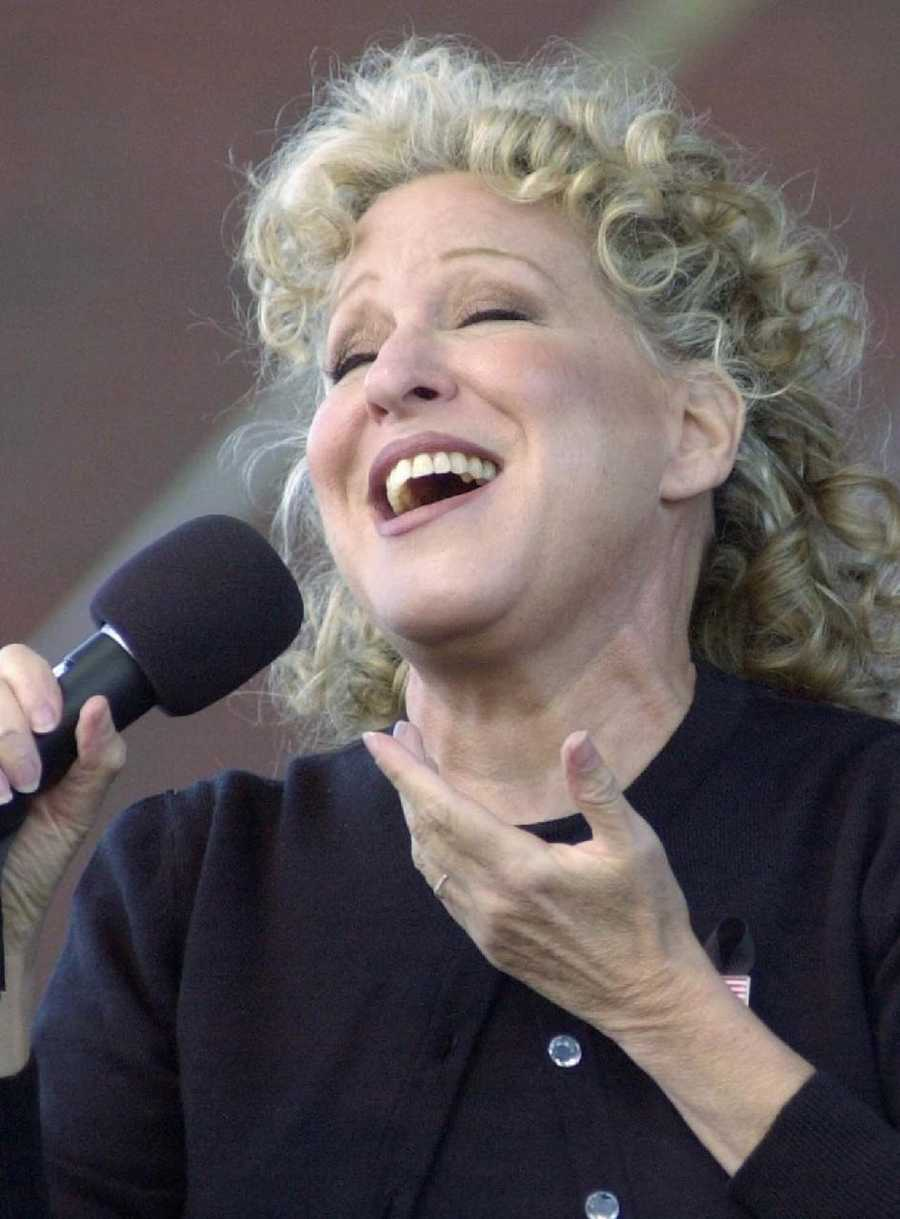 """Singer-actress Bette Midler sings """"Wind Beneath My Wings"""" during memorial services in Boston, Sept. 26, 2001, held for the 22 airlines employees killed in the terrorist attack on the World Trade Center."""