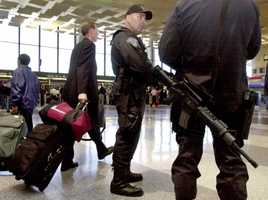 Massachusetts State Police troopers armed with automatic weapons patrol the terminal at Logan International Airport, Sept. 15, 2001.