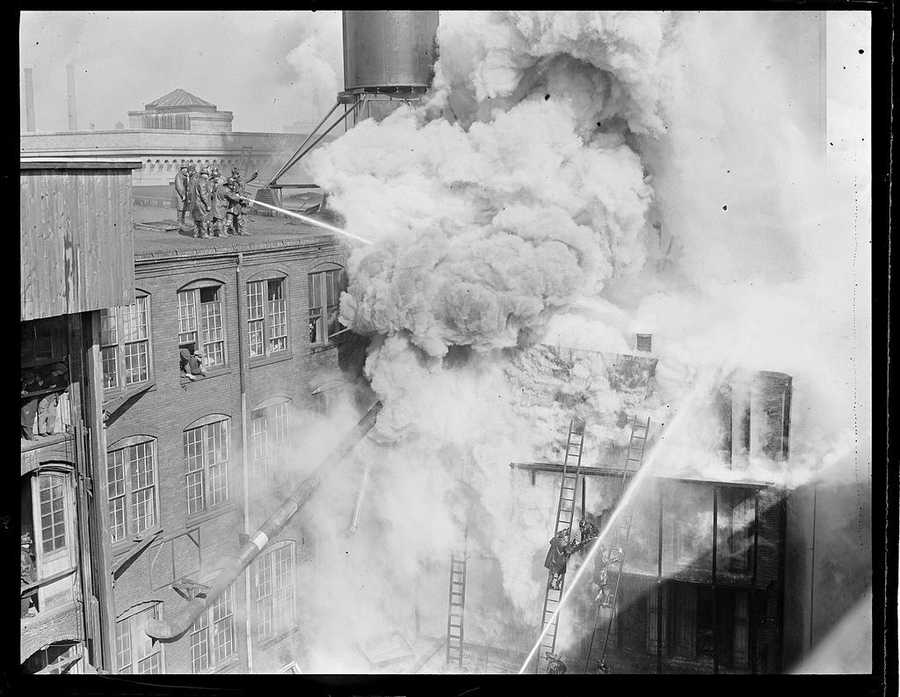 Three alarm fire on Thayer Street, South End, near Fire headquarters in 1923