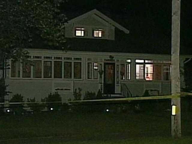 Police tape off the home of Nathaniel Fujita, her ex boyfriend.