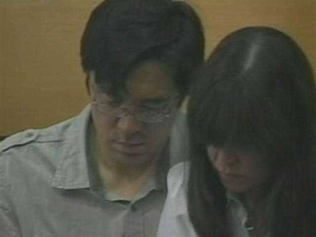 Fujita's parents at the arraignment. Fujita's father is a music professor at Berklee College of Music.