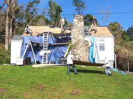Repair work being down on a damaged Monson home.