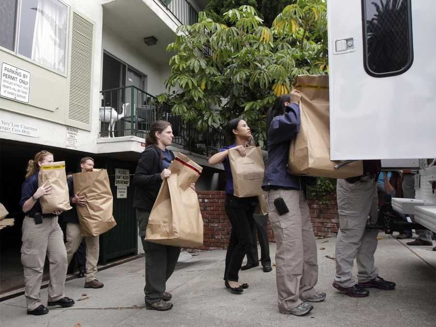 "FBI agents load evidence bags into a truck outside an apartment complex where James ""Whitey"" Bulger and Catherine Greig were arrested."