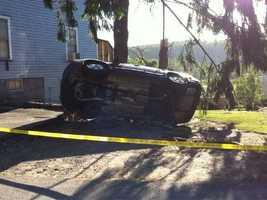 An overturned car in Monson