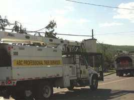 Trucks arriving to remove debris in Monson