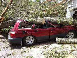 A crushed car in Monson