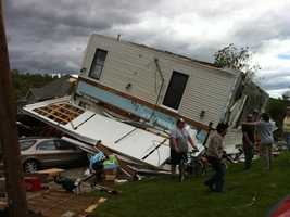 A house flipped on its side in Monson.