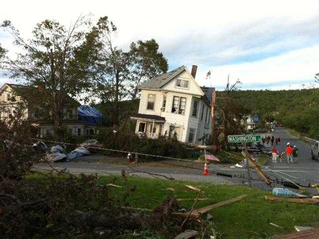 A house literally tipping in Monson
