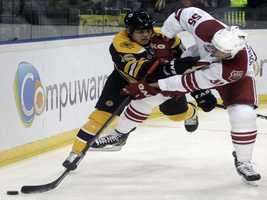 Ed Jovanovski, right, of Phoenix Coyotes challenges Nathan Horton, left, of Boston Bruins during their NHL hockey match in Prague, Czech Republic, Saturday, Oct. 9, 2010.