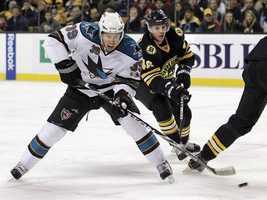 San Jose Sharks center Logan Couture (39) shoots and scores as Boston Bruins center David Krejci (46) defends during the first period of an NHL hockey game in Boston Saturday, Feb. 5, 2011.