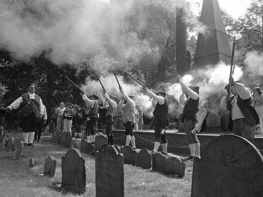 Minutemen fire salute in Boston's Old Granary Burial Ground, July 4, 1976