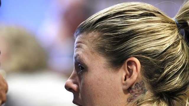 Kristen LaBrie, looking over to her family, is sentenced to eight to 10 years in prison at Lawrence Superior Court in Lawrence, Mass., Friday, April 15, 2011. LaBrie was convicted of attempted murder for withholding cancer medications from her autistic son.