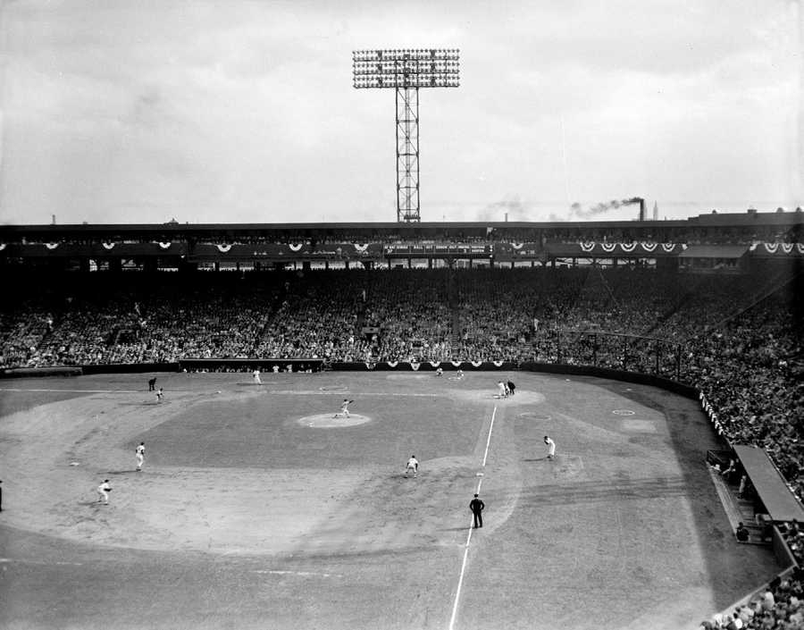 This general view of Fenway Park shows part of the 32,563 baseball fans as they cheer the Boston Red Sox on to victory against the Baltimore Orioles in the 1956 American League opener in Boston, April 17, 1956. Boston won, 8-1.