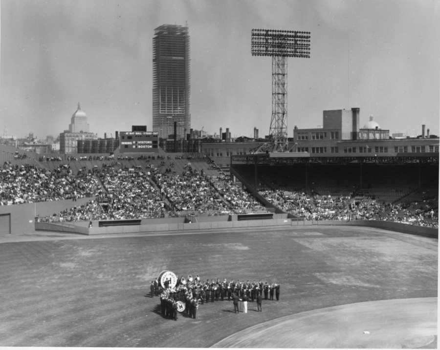 The Harvard University Band plays during Opening Day ceremonies in 1963. The Prudential Building under construction in background.