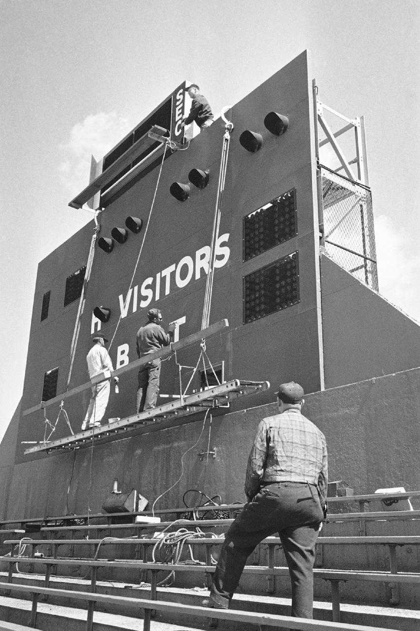 Painters and other workmen put finishing touches to the new score board which has been installed behind the right field bleachers at Fenway Park in Boston, April 9, 1963, as they prepare for opening game. The Boston Red Sox will meet the Baltimore Orioles in Fenway opener on April 16.