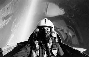Christa McAuliffe rides in a T-38 trainer jet over Galveston Bay during training for the launch of Space Shuttle Challenger.