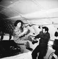 McAuliffe floats weightlessly for a few seconds aboard a KC-135 aircraft Oct. 17, 1985, while testing an experiment.