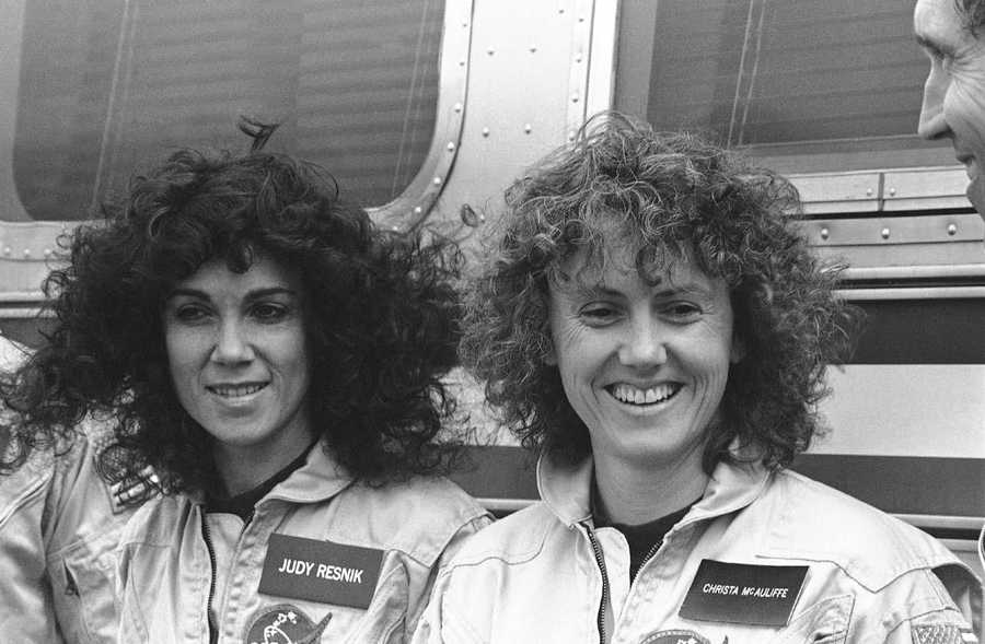 McAuliffe, right, and mission specialist Judy Resnick talk with reporters at Kennedy Space Center, Jan. 9, 1986.