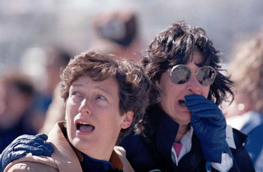 Two spectators react in horror after the Challenger exploded.