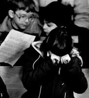 A young girl rubs her eyes during a memorial service for Christa McAuliffe at St. John's the Evangelist Church in Concord, N.H., Jan. 29, 1986.