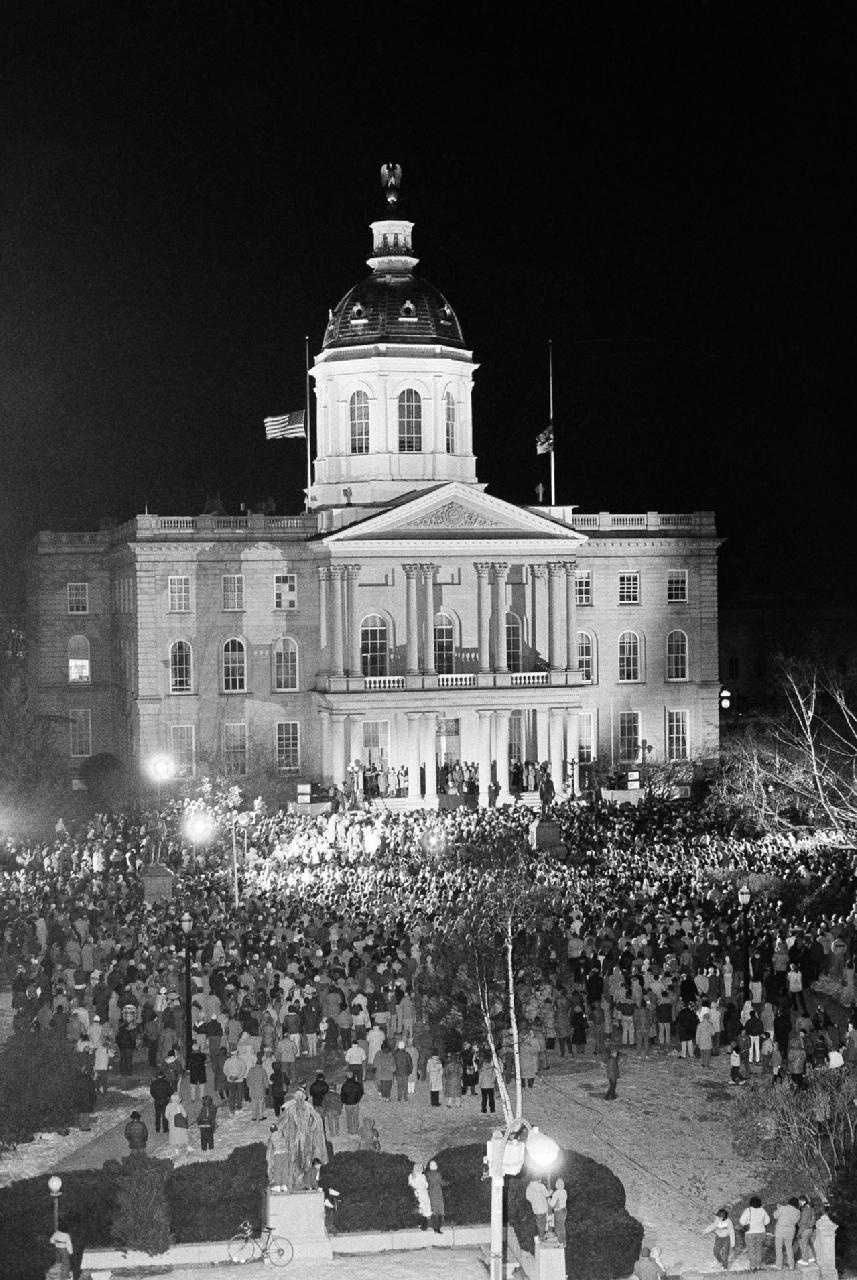 An estimated crowd of 2500 peopled gather around the foot of the Statehouse steps in Concord, N. H.,to participate in a memorial service for Christa McAuliffe