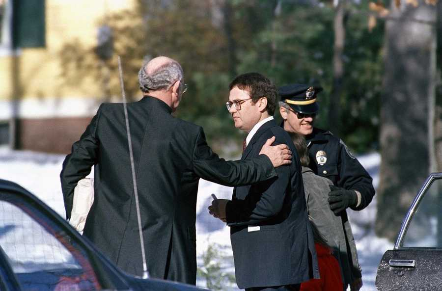 Steven McAuliffe is consoled by an unidentified man outside McAuliffe's Concord, N.H. home, Monday, Feb. 3, 1986, following funeral services for his wife, Christa.