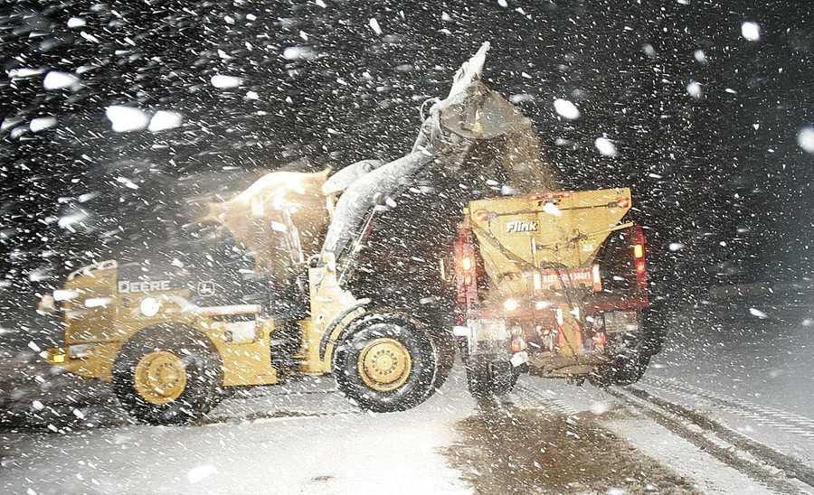 At the Marshfield DPW salt shed off Clay Pit Road a front end loader fills a town truck with road sand.