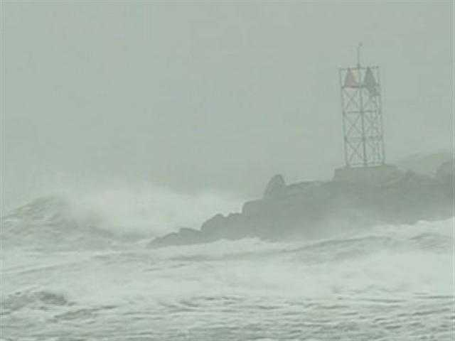 The lighthouse in Scituate as the blizzard whips the wind.