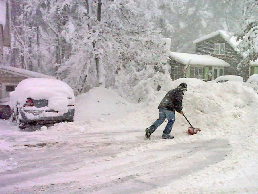 This Sharon, Mass., resident shoveled all morning to try to keep up.