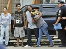 Friends of shooting victims grieve in Boston.
