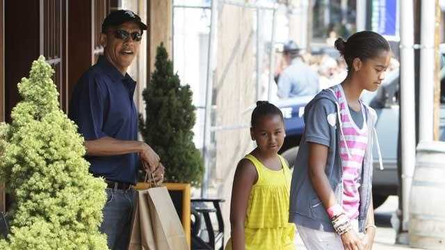 President Barack Obama, with his daughters Malia Obama and Sasha Obama, leave the Bunch of Grapes book store in Vineyard Haven, Mass., Friday, Aug. 20, 2010, where the First family is vacationing on Martha's Vineyard.