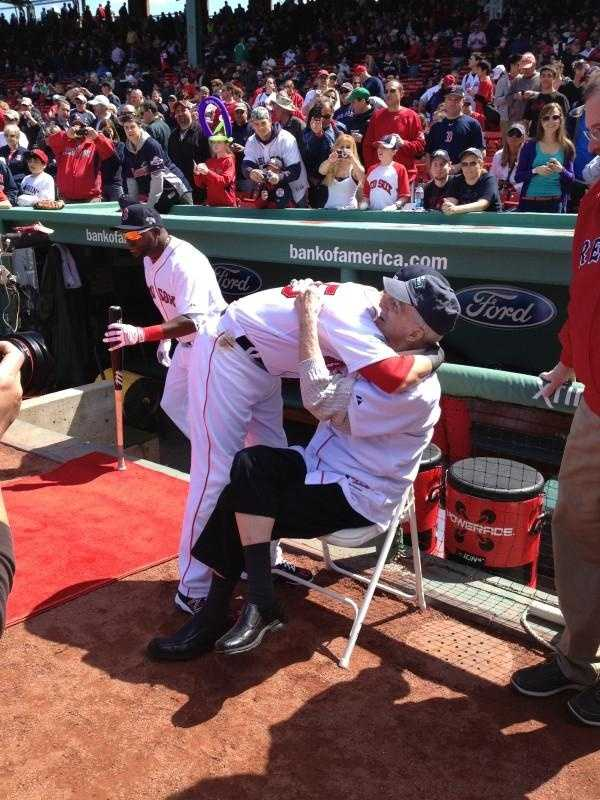 Dustin Pedroia hugs Pesky on Opening Day 2012.