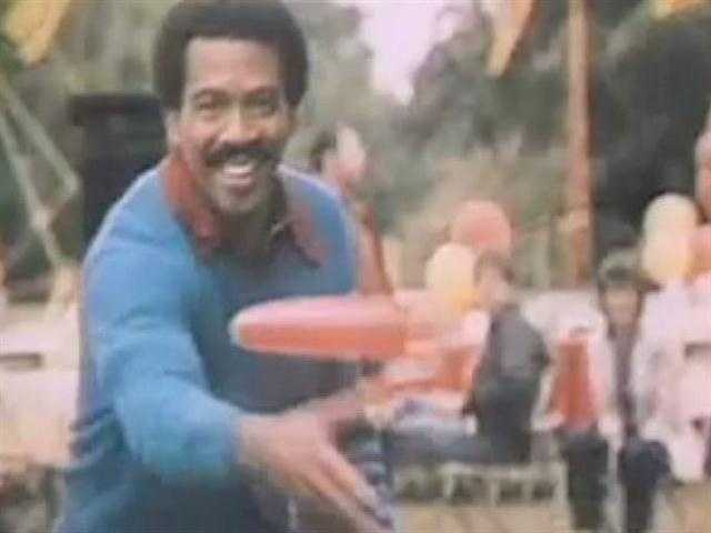 Jim Boyd tosses a Frisbee in a 1980 station promo