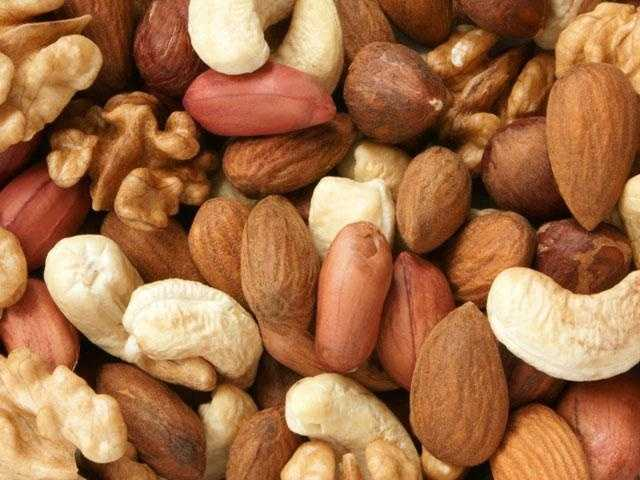 What does make a difference: Eating too many nuts of any type. Limit your daily nibbles to one ounce and preferably to one of the heart-healthy choices like almonds or walnuts.