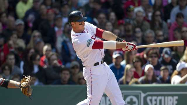 Boston Red Sox's Will Middlebrooks hits a grand slam off Baltimore Orioles' Tommy Hunter in the fifth inning of a baseball game at Fenway Park, in Boston, Sunday, May 6, 2012.