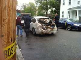 The car, which had its trunk ripped off and rear window smashed in, had to be towed from the scene.