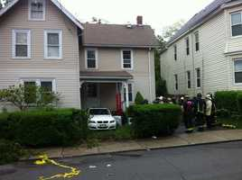 The car hit the house with such force, that pieces of the porch were wedged in the car.