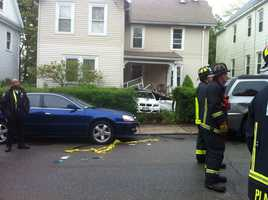 Boston police said an 8-year-old boy driving a BMW crashed into a Mattapan neighbor's porch Wednesday morning.