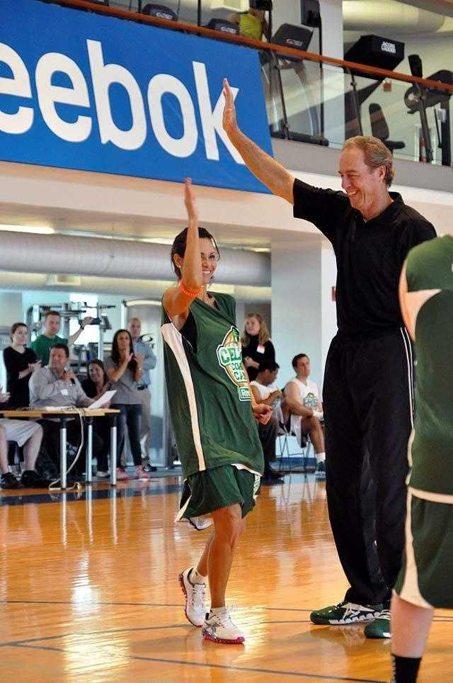 Liz with Boston Celtics legend Dave Cowens playing basketball at a charitable fundraising event.
