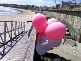 Balloons hang near the area where the girl went missing.