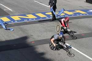 Women's wheelchair winner Shirley Reilly crosses the finish line 1 second ahead of Wakako Tsuchida. Reilly's winning time was1:37:36