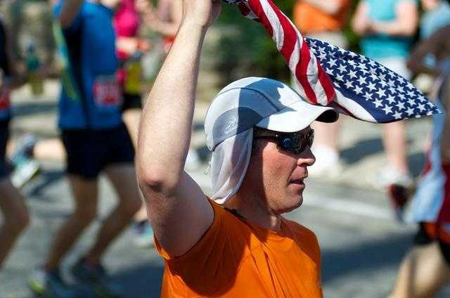 A runner waves a flag along the course.