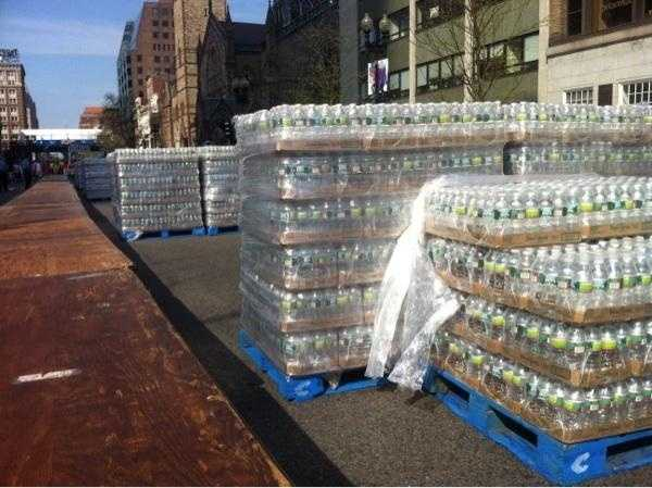 Cases of water awaited runners at the finish line in Boston