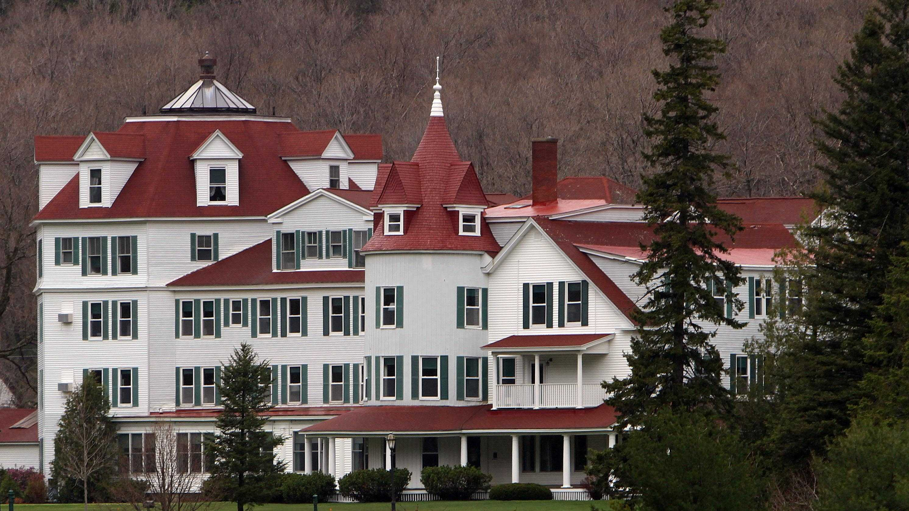 A large sign is seen in front of the Balsams Hotel where an auction was held to clear out the nearly 150-year-old resort. The resort was sold last year to two businessmen for $2.3 million.