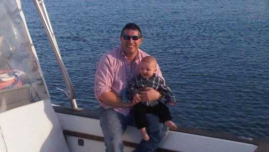 John Redler with his 9-month-old son, John Jr.