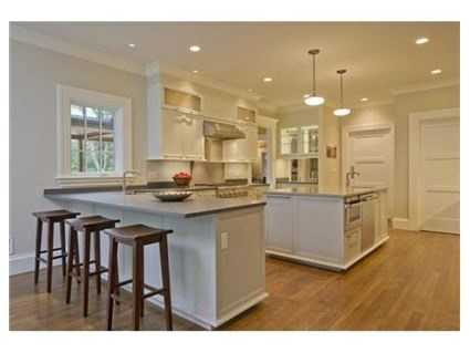 It is a true gourmet kitchen with custom cabinets.