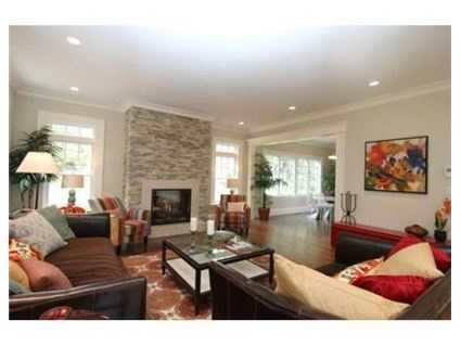 The family room also has a stone fireplace.