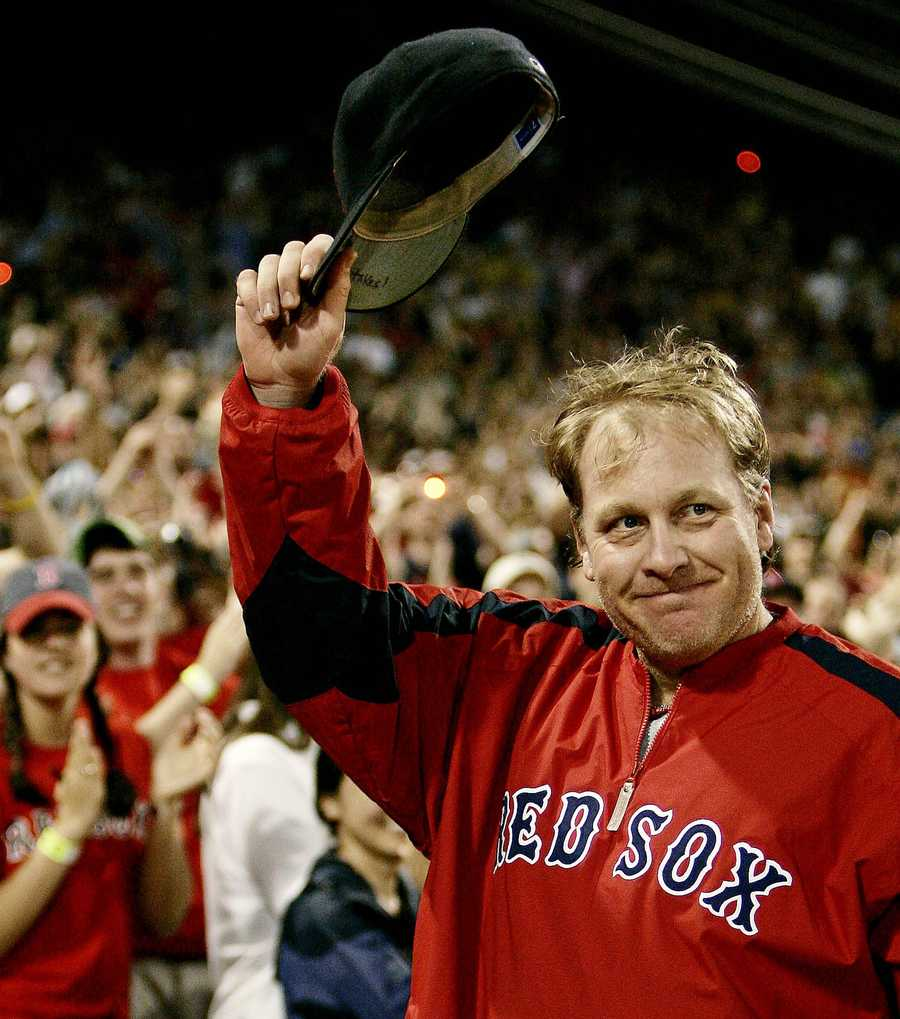 Curt Schilling returning to the field and gesturing to fans after earning the 200th win of his career, a 6-4 victory over the Tampa Bay Devil Rays on May 27, 2006.