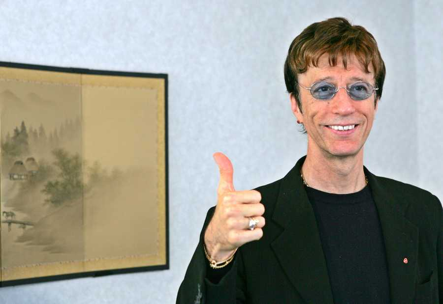"Robin Gibb was one of three brothers who made up the disco group the Bee Gees behind ""Saturday Night Fever"" and other hits from the 1970s. With their matching white suits, soaring high harmonies and polished, radio-friendly records, they remain one of the essential touchstones to that ultra-commercial era,"" the Rock and Roll Hall of Fame says on its website. (22 December 1949 – 20 May 2012)"