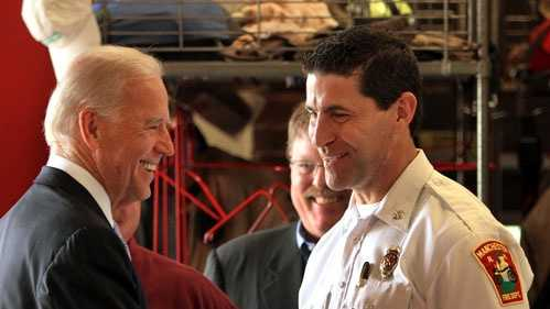 Vice President Joe Biden greets firefighters at the fire department station in Manchester, N.H., Tuesday, May 22, 2012.